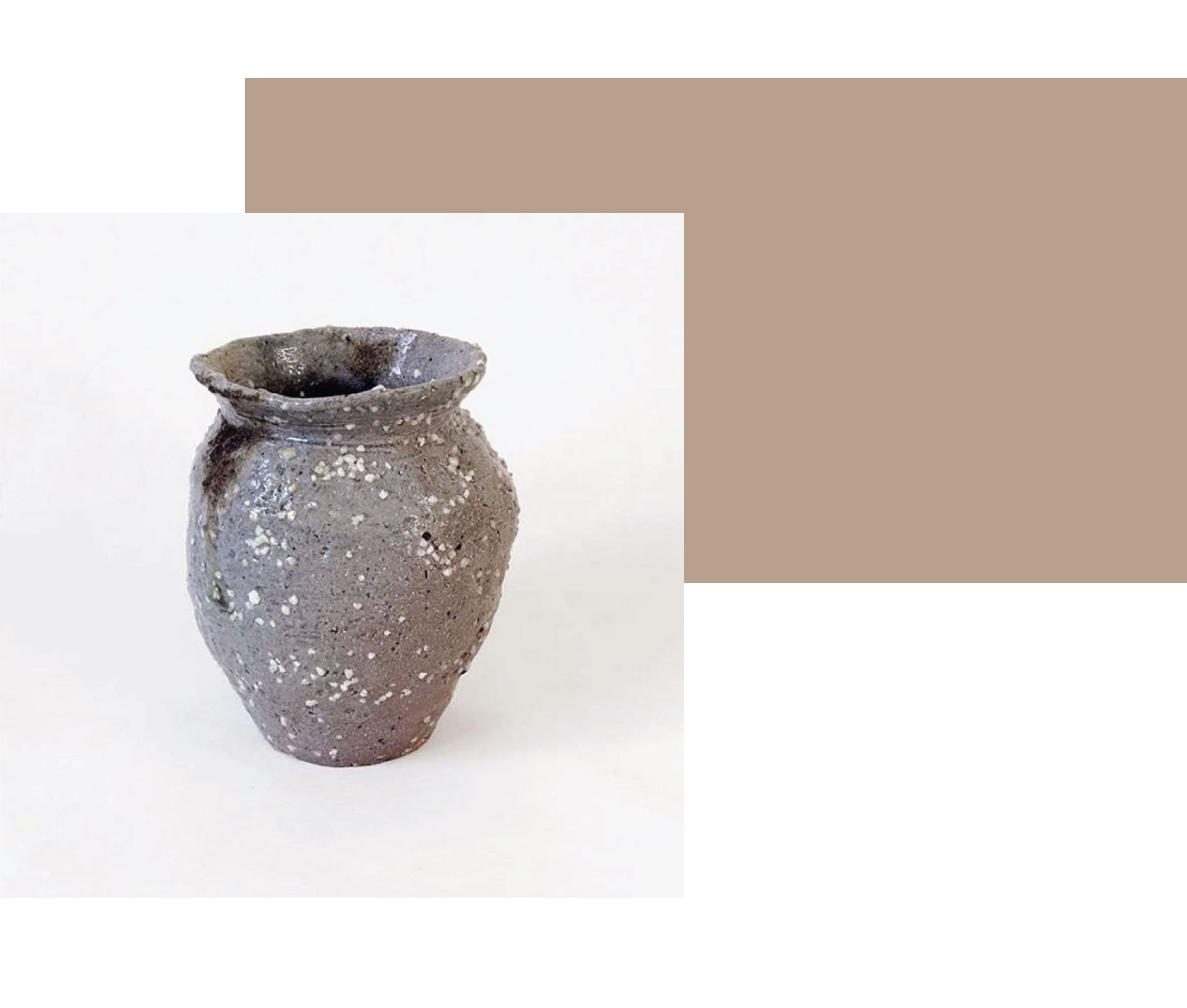 A single pale purple salt fired vase with black ash and white speckles, on a white background, by New Zealand ceramist and ceramic artist Dave Marshall.