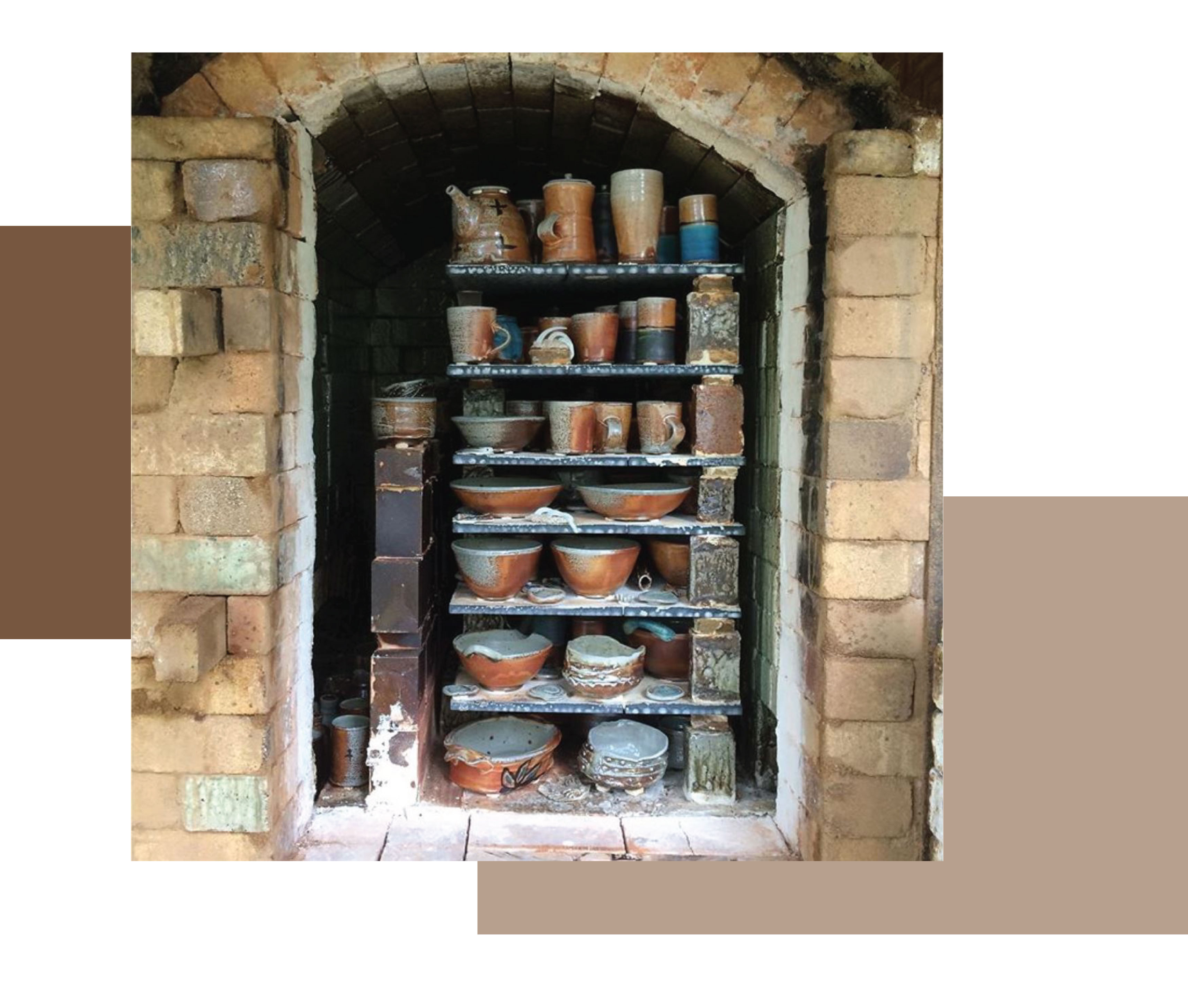 View into an opened wood kiln showing stacks of blue, grey and brown pots, by New Zealand ceramists and potters Duncan Shearer and Charde Honey of Rahu Road Pottery.